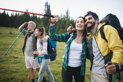 Successful Group of Happy Friends on Mountain Top, Cheering. Successful Group of HappyYoung Friends on Mountain Top, Cheering royalty free stock image