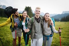 Successful Group of Happy Friends on Mountain Top, Cheering. Successful Group of HappyYoung Friends on Mountain Top, Cheering royalty free stock images