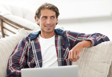 Successful guy working on laptop and looking at camera. view from above Royalty Free Stock Photos