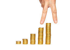 Successful hand on the top of gold coin's stack. Royalty Free Stock Image