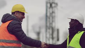 Successful handshake deal. Reaching an agreement on construction site stock footage