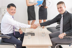 Successful handshake of two businessmen at office Royalty Free Stock Photography