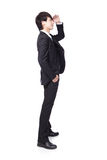Successful handsome business man looking away. To empty copy space in full length isolated on white background, mode is a asian male Stock Photography