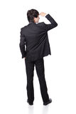 Successful handsome business man looking away. To empty copy space in full length isolated on white background, mode is a asian male Royalty Free Stock Image