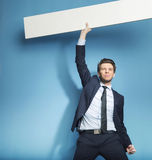 Successful handsome guy with the empty board Royalty Free Stock Photography