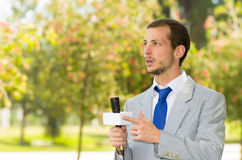 Successful handsome male news reporter wearing Royalty Free Stock Photo