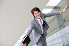 Successful and happy. Just graduated young man from business school royalty free stock photo