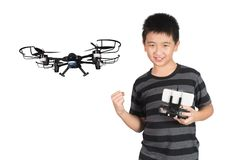 Successful happy Asian boy holding radio remote control for dron Stock Photos