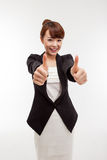 Successful happy Asian businesswoman showing thumb Stock Photos