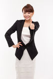 Successful happy Asian businesswoman showing thumb Stock Photo