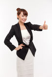 Successful happy Asian businesswoman showing thumb Stock Images