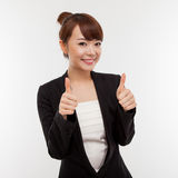 Successful happy Asian businesswoman showing thumb Stock Image