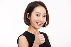 Successful happy Asian businesswoman showing thumb. Stock Photo