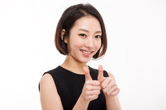 Successful happy Asian businesswoman showing thumb. Stock Images