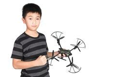 Successful happy and attractive Asian boy holding hexacopter drone and punching the air with his fist, isolated on white. Successful happy and attractive Asian royalty free stock image