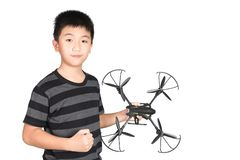 Successful happy and attractive Asian boy holding hexacopter drone and punching the air with his fist, isolated on white. Successful happy and attractive Asian royalty free stock images