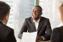 Successful happy black male candidate getting hired, got a job
