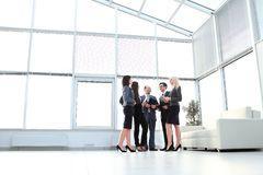 Successful and happy business team in modern office lobby. photo with copy space Royalty Free Stock Images