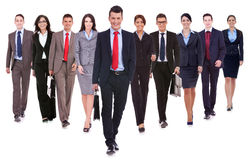 Successful happy business team walking. Towards the camera on white background Royalty Free Stock Image