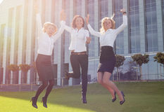 Successful and happy business woman jumping up Royalty Free Stock Images