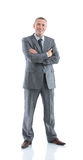 Successful happy businessman in a gray business suit, openly smi. Closeup of happy successful businessman in a business suit hands folded in front of him on a Royalty Free Stock Photo