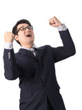 Successful happy businessman rejoicing raising his face to the s Royalty Free Stock Images