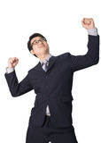 Successful happy businessman rejoicing raising his face to the s Stock Photo