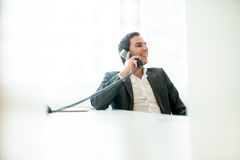 Successful happy businessman talking on a phone Stock Photography