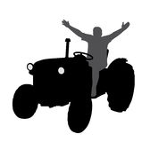Successful happy farmer on tractor with hands up Royalty Free Stock Photo