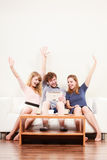 Successful happy friends with tablet at home. Stock Image