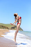Successful happy girl jumping on the beach Royalty Free Stock Photo