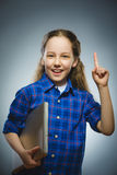 Successful happy girl show thumb up and using laptop isolated grey background. Closeup portrait successful happy girl show thumb up and using laptop isolated Royalty Free Stock Photos