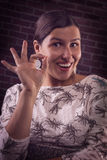 Successful happy girl showing OK gesture Stock Photography