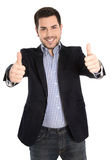 Successful happy isolated young businessman with thumbs up. Stock Photo