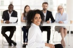 Successful happy mixed race applicant with hr recruiting team po stock images