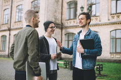 Successful happy students standing near campus or university outside royalty free stock images