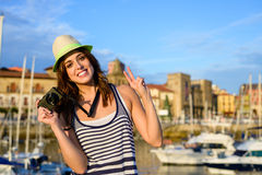 Successful happy tourist with camera by the harbor Stock Image