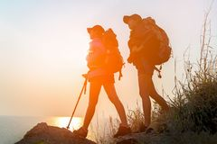 Successful Hiker women hiking with backpack Royalty Free Stock Images