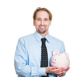 Successful holding piggy Stock Photos