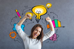 Successful idea concept. Cheerful young caucasian female celebrating success on concrete background with colorful business sketch. Successful idea concept Royalty Free Stock Photo