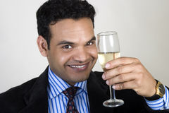 Successful Indian business man toasting Stock Photos