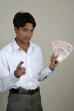 Successful indian with indian currency. Indian guy with indian money with expression, you can make money too Royalty Free Stock Photography