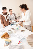 Successful interior designer woman with two client