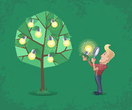 Successful Inventor. Happy blond guy close looking fresh idea-lightbulb through magnifying glass near the idea-tree. Metaphoric illustration on the subject of Royalty Free Stock Photography