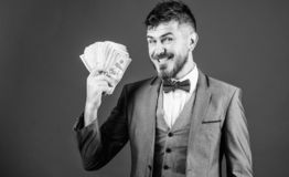A successful investment. Currency broker with bundle of money. Making money with his own business. Bearded man holding. Cash money. Rich businessman with us royalty free stock photo