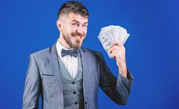 A successful investment. Currency broker with bundle of money. Making money with his own business. Bearded man holding. Cash money. Rich businessman with us stock photo