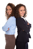 Successful isolated young business woman - real twins working to Royalty Free Stock Photo