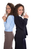 Successful isolated young business woman - real twins working to Stock Photos