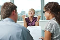 Successful job interview. Happy woman applicant got the job by a successful job interview. Over the shoulder view Royalty Free Stock Images