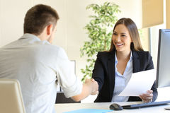 Successful job interview. With boss and employee handshaking royalty free stock photo